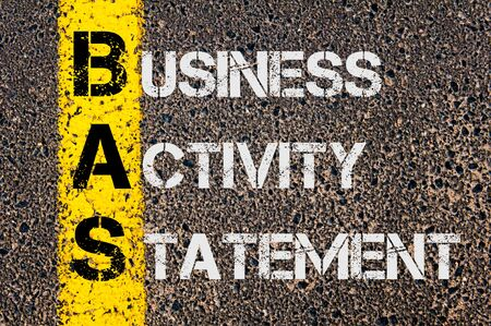 business activity: Concept image of Business Acronym BAS as Business Activity Statement  written over road marking yellow paint line.