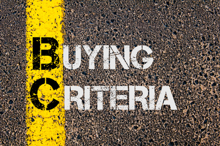 criteria: Concept image of Business Acronym BC as Buying Criteria  written over road marking yellow paint line.