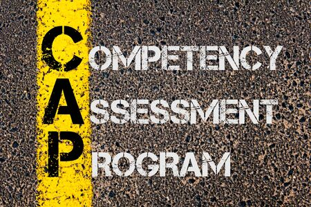 competency: Concept image of CAP as Competency Assessment Program written over road marking yellow paint line.