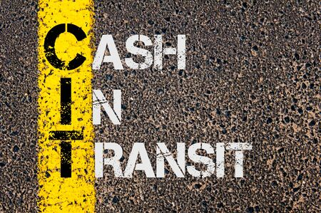 Concept image of Business Acronym  CIT as Cash in Transit  written over road marking yellow paint line.