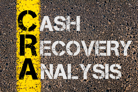 road to recovery: Concept image of Business Acronym CRA as Cash Recovery Analysis  written over road marking yellow paint line. Stock Photo
