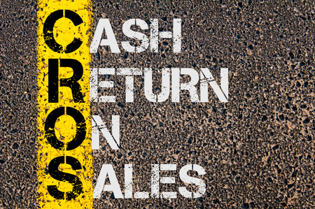 Concept image of Business Acronym CROS as Cash Return On Sales  written over road marking yellow paint line.