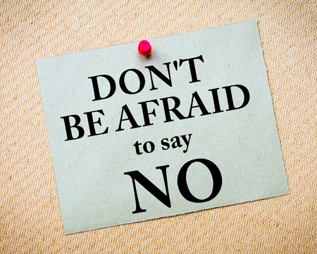 no idea: Dont Be Afraid To Say NO Message written on recycled paper note pinned on cork board