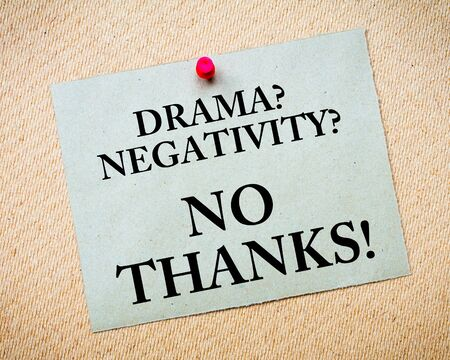 Drama Negativity No Thanks! Message written on recycled paper note pinned on cork board