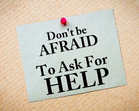 Don\'t Be Afraid To Ask For Help written on recycled paper note pinned on cork board Standard-Bild