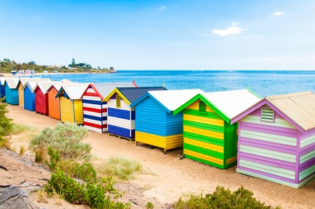 Melbourne, Australia - February 21, 2015: Brighton bathing boxes,  with classic Victorian architectural features, are a popular Bayside icon and cultural asset at Brighton Beach, Melbourne, Australia 報道画像