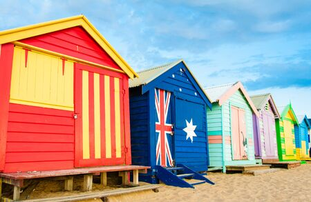 brighton: Melbourne, Australia - February 21, 2015: Brighton bathing boxes,  with classic Victorian architectural features, are a popular Bayside icon and cultural asset at Brighton Beach, Melbourne, Australia Editorial