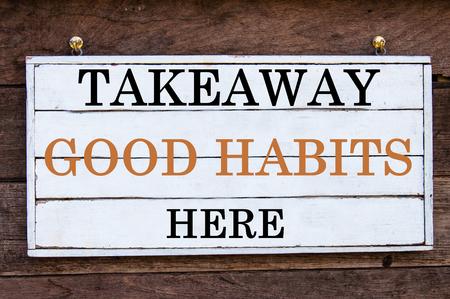 good habits: Takeaway Good Habits Here Inspirational message written on vintage wooden board. Motivation concept image