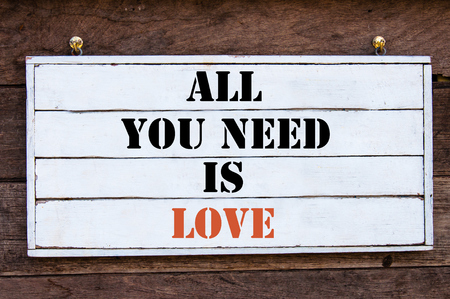 in need of space: All You Need Is Love Inspirational message written on vintage wooden board. Motivation concept image Stock Photo