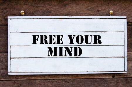 free your mind: Free Your Mind Inspirational message written on vintage wooden board. Motivation concept image