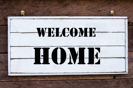 welcome home: Welcome Home Inspirational message written on vintage wooden board. Motivation concept image