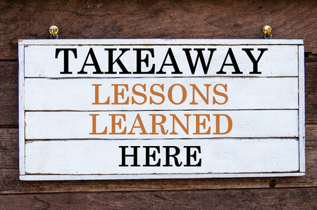 learned: Takeaway Lessons Learned Here Inspirational message written on vintage wooden board. Motivation concept image
