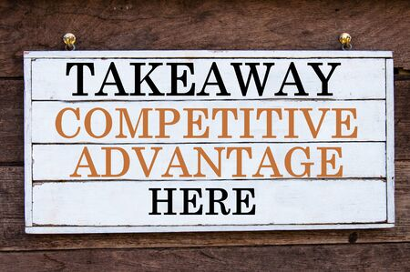 competitive advantage: Takeaway Competitive Advantage Here Inspirational message written on vintage wooden board. Motivation concept image Stock Photo