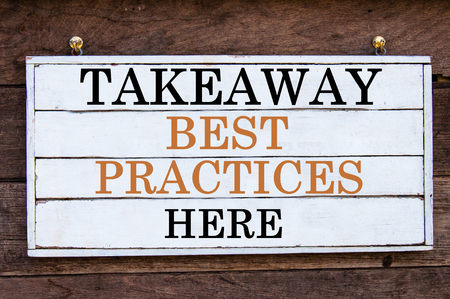 best practices: Takeaway Best Practices Here Inspirational message written on vintage wooden board. Motivation concept image