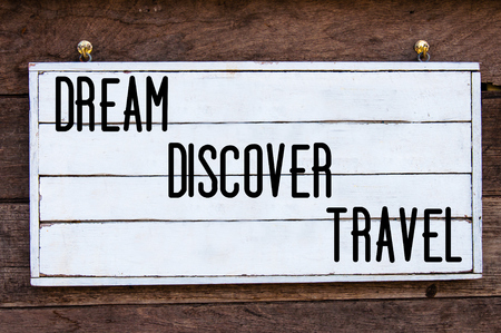 discover: Dream, Discover, Travel Inspirational message written on vintage wooden board. Motivation concept image Stock Photo