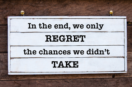 In the end, we only regret the chances we didnt take Inspirational message written on vintage wooden board. Motivational concept image Stock Photo