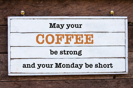 strong message: May Your Coffee be strong and your Monday be short message written on vintage wooden board. Motivational concept image