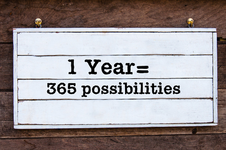 possibilities: One Year equal 365 possibilities Inspirational message written on vintage wooden board. Motivational concept image Stock Photo