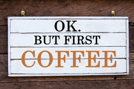 but: OK. But first Coffee Inspirational message written on vintage wooden board. Motivational concept image