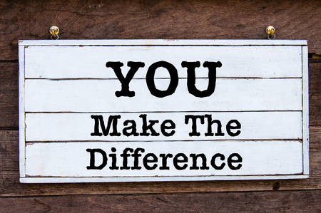 You Make The Difference, Inspirational message written on vintage wooden board. Motivational concept image