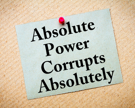 absolutely: Absolute Power Corrupts Absolutely Saying. Recycled paper note pinned on cork board. Concept Image
