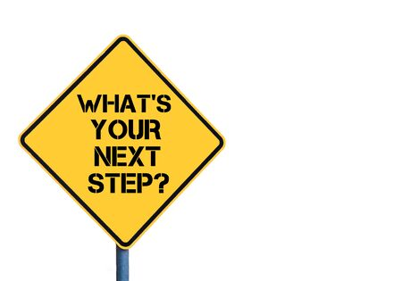 Yellow roadsign with Whats Your Next Step message isolated on white background Stock Photo