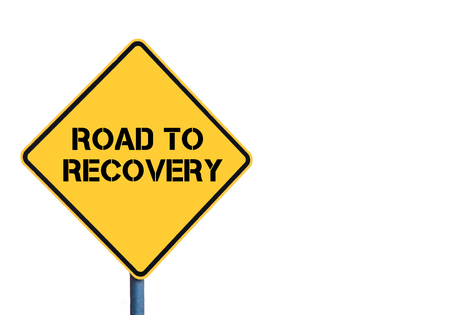 road to recovery: Yellow roadsign with Road To Recovery message isolated on white background Stock Photo