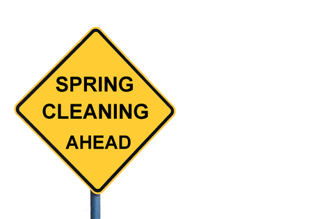 spring cleaning: Yellow roadsign with SPRING CLEANING AHEAD message isolated on white background