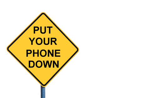 put forward: Yellow roadsign with PUT YOUR PHONE DOWN message isolated on white background