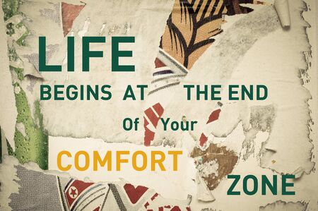begins: Life begins at the End of your Comfort Zone - Inspirational message written on vintage grunge background with Old Torn Posters. Motivational concept image Stock Photo