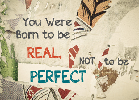 to be or not to be: You were born to be Real, Not to be Perfect - Inspirational message written on vintage grunge background with Old Torn Posters. Motivational concept image Stock Photo