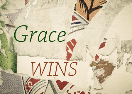 wins: Grace Wins - Inspirational message written on vintage grunge background with Old Torn Posters. Motivational concept image