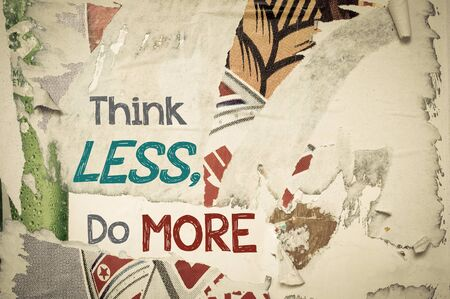 frame less: Think Less Do More - Inspirational message written on vintage grunge background with Old Torn Posters. Motivational concept image Stock Photo