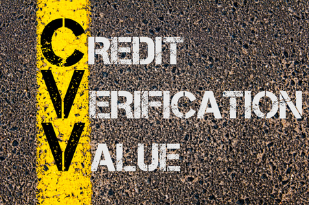 cvv: Concept image of Business Acronym CVV as CREDIT VERIFICATION VALUE written over road marking yellow paint line.