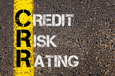 credit risk: Concept image of Business Acronym CRR as CREDIT RISK RATING written over road marking yellow paint line.