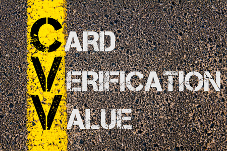 cvv: Concept image of Business Acronym CVV as CARD VERIFICATION VALUE written over road marking yellow paint line. Stock Photo