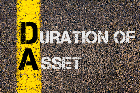 Duration: Concept image of Business Acronym DA as DURATION OF ASSET written over road marking yellow paint line. Stock Photo