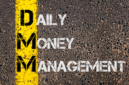money management: Concept image of Business Acronym DMM as DAILY MONEY MANAGEMENT written over road marking yellow paint line.