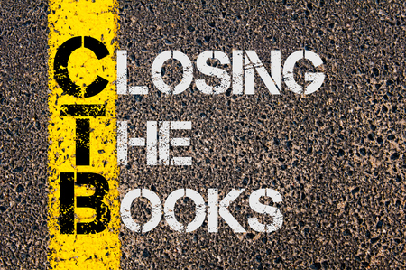 cerrando negocio: Concept image of Business Acronym CTB as CLOSING THE BOOKS written over road marking yellow paint line.