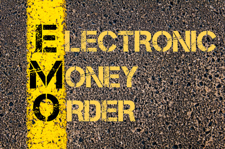 emo: Concept image of Business Acronym EMO as ELECTRONIC MONEY ORDER written over road marking yellow paint line. Stock Photo