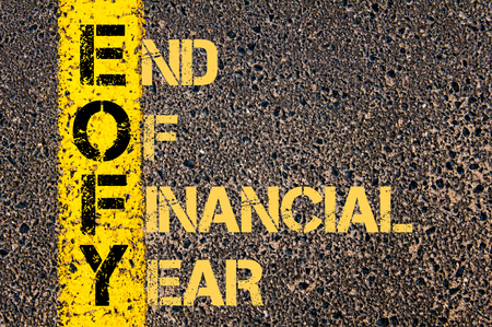 end of the line: Concept image of Business Acronym EOFY as END OF FINANCIAL YEAR written over road marking yellow paint line.