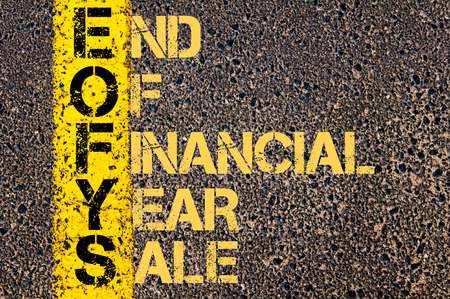 end of the line: Concept image of Business Acronym EOFYS as END OF FINANCIAL YEAR SALE written over road marking yellow paint line.