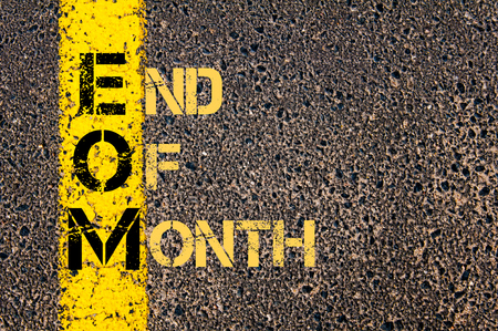 Concept image of Business Acronym EOM as END OF MONTH written over road marking yellow paint line.