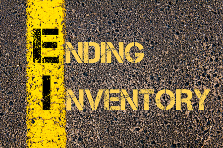 ei: Concept image of Business Acronym EI as ENDING INVENTORY written over road marking yellow paint line.