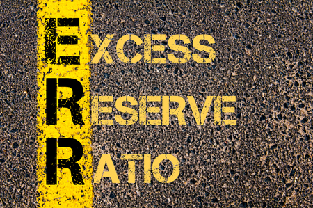 excess: Concept image of Business Acronym ERR as EXCESS RESERVE RATIO written over road marking yellow paint line.
