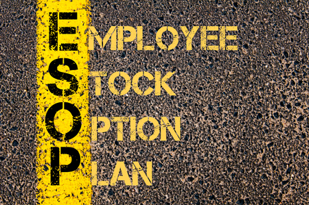 employee stock option: Concept image of Business Acronym ESOP as Employee Stock Option Plan written over road marking yellow paint line. Stock Photo