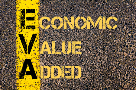 eva: Concept image of Business Acronym EVA as ECONOMIC VALUE ADDED written over road marking yellow paint line.