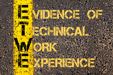 work experience: Concept image of Business Acronym ETWE as Evidence of Technical Work Experience written over road marking yellow paint line.