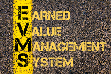 earned: Concept image of Business Acronym EVMS as Earned Value Management System written over road marking yellow paint line.