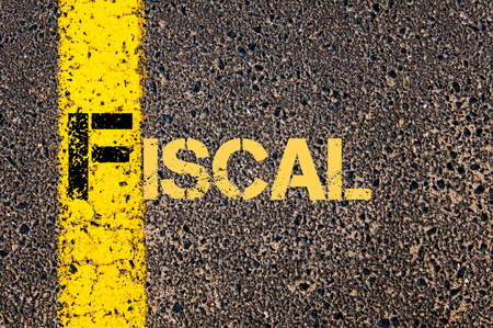 fiscal: Concept image of Business Acronym F as FISCAL written over road marking yellow paint line. Stock Photo